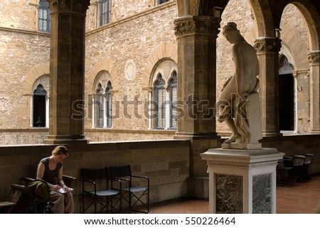 Florence, Italy-June 12, 2015. Female sketching one of the many statues of the National Museum of Bargello, a former barracks and prison, now an art museum