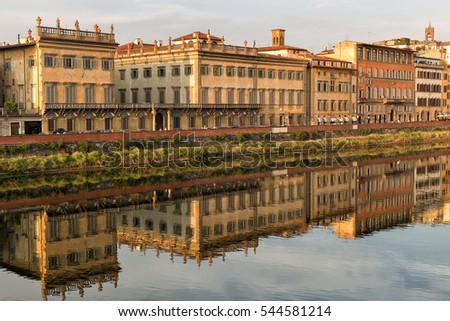 Florence, Italy-June 12, 2015.Historic buildings reflecting the Arno River, Florence, Italy, in warm late afternoon sunlight