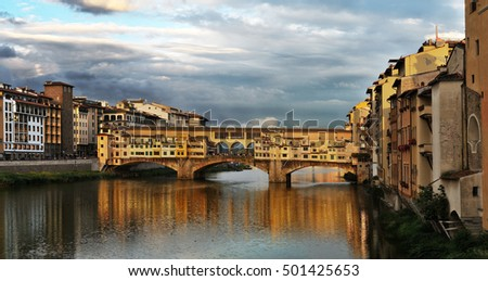 FLORENCE, ITALY - JUNE 03, 2016: Ponte Vecchio bridge over the river Arno. Bridge was opened in 1345 and is one of the biggest tourist attractions in Florence. Italy