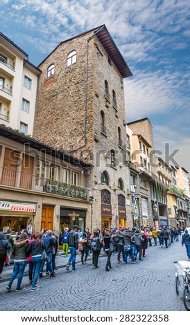 FLORENCE, ITALY - MARCH 14, 2015: Pedestrian street full of people near the Ponte Vecchio.
