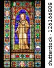 FLORENCE, ITALY - MARCH 24: Stained glass window with a Saint in the Abbey of Holy Trinity on March 24, 2012 in Florence, Italy - stock photo