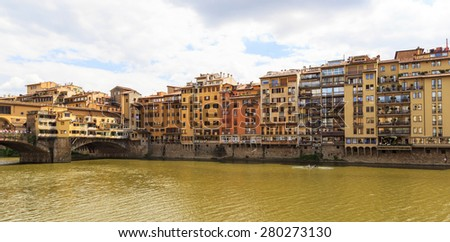 FLORENCE, ITALY - MAY 20, 2014: day view of Ponte Vecchio in Florence, Italy. Florence, acknowledged by Unesco as a World Heritage Site, is home to some of the most famous works of art on earth - stock photo