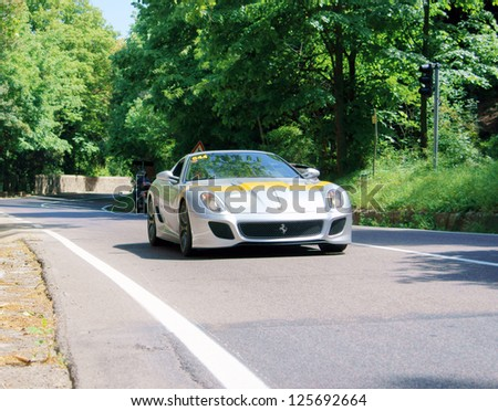FLORENCE, ITALY - MAY 19: Ferrari 599 GTO along Via Bolognese during the 1000 miles on May 19, 2012 in Florence, Italy
