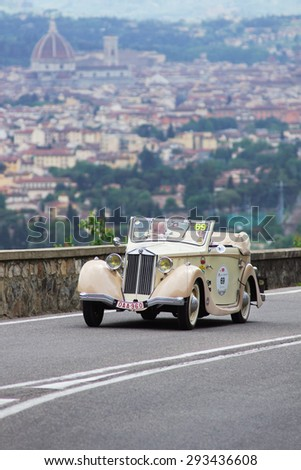 "FLORENCE, ITALY - MAY 19: Lancia car along Via Bolognese during the 1000 miles on May 19, 2013 in Florence, Italy . ""Mille Miglia"" is a car race attempted by many celebrities"