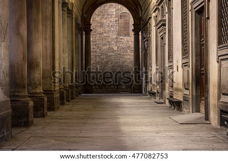 Florence, Italy - May 2, 2016: Long passage along columns in perspective. Colonnade of Uffizi Gallery in Florence, Italy
