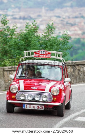 """FLORENCE, ITALY - MAY 19: Mini Cooper along Via Bolognese during the 1000 miles on May 19, 2013 in Florence, Italy . """"Mille Miglia"""" is a car race attempted by many celebrities - stock photo"""