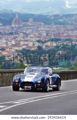 """FLORENCE, ITALY - MAY 19: Old Car along Via Bolognese during the 1000 miles on May 19, 2013 in Florence, Italy . """"Mille Miglia"""" is a car race attempted by many celebrities - stock photo"""