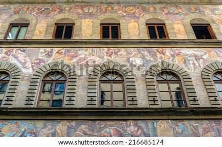 FLORENCE, ITALY - MAY 11, 2014: Old house, decorated with frescoes on the street. Many of the buildings in Florence are included in the UNESCO World Heritage list. - stock photo