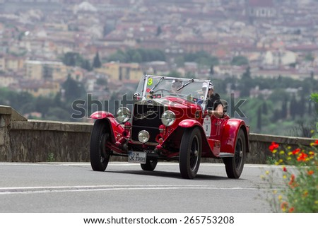 "FLORENCE, ITALY - MAY 19: 665 Superba MM along Via Bolognese during the 1000 miles on May 19, 2013 in Florence, Italy . ""Mille Miglia"" is a car race attempted by many celebrities - stock photo"