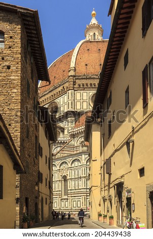 FLORENCE, ITALY - MAY 20-Tourists visiting the sights on the Piazza San Giovanni and del Duomo in May20,2014 in Florence
