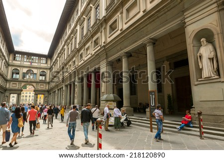 FLORENCE, ITALY - MAY 11, 2014: Tourists walk next to the famous Uffizi Gallery. - stock photo