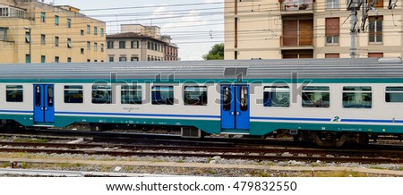 FLORENCE, ITALY - MAY 6, 2016: Trenitalia company train in movement near Florence. Trenitalia is the primary train operator in Italy