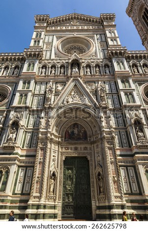 FLORENCE - ITALY MAY 20 2014 - view of cathedral SANTA MARIA DEL FIORE in Florence with visitors. This is one of the best know tourist location of Italy. The churches has just  recently  renovated. - stock photo