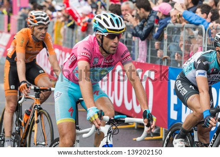 FLORENCE, ITALY - MAY 12: Vincenzo Nibali and other riders at the end of the 9th stage of 2013 Giro d'Italia on May 12, 2013 in Florence, Italy - stock photo