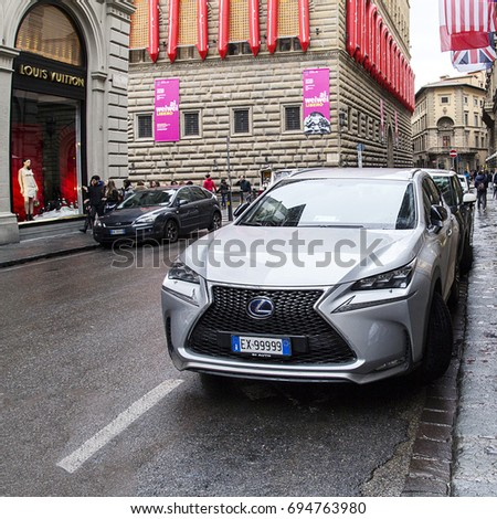 Florence, Italy: November 2016: A Lexus NX is parked near a Louis Vuitton clothing store. The new SUV was introduce to European market in 2014. The NX is available with hybrid version.