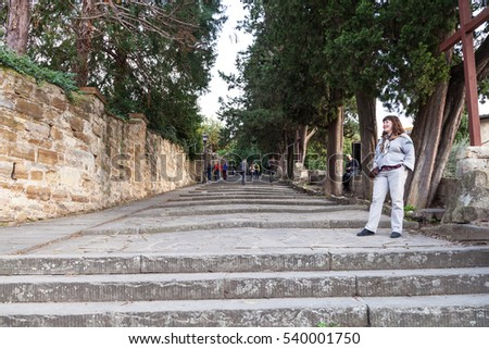 FLORENCE, ITALY - NOVEMBER 4, 2016: tourists on San Niccolo steps to Piazzale Michelangelo in Florence city. This square was designed by architect Giuseppe Poggi and built in 1869