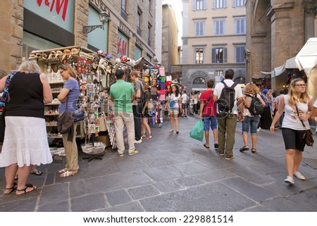 FLORENCE, ITALY ON AUGUST 25. Snapshot in the street on August 25, 2014 in Firenze, Florence, Italy. Unidentified people in the street. Stores and market places.