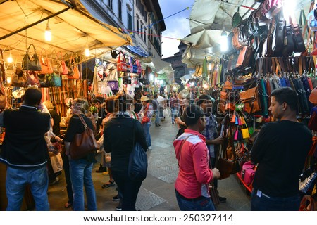 FLORENCE, ITALY ON OCTOBER 17. Snapshot in the street on October 17, 2014 in Firenze, Florence, Italy. View of traditional leather goods market on dell` Ariento street - stock photo