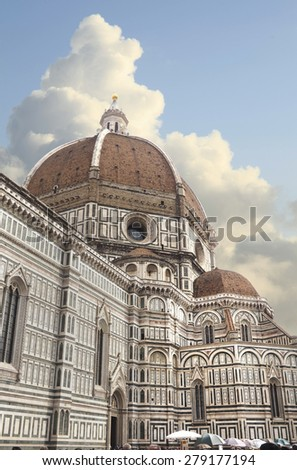 Florence Italy's Duomo or Basilica di Santa Maria del Fiore on a Beautiful Cloudy Day - stock photo