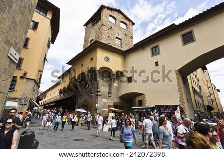 FLORENCE, ITALY - SEPTEMBER 2, 2014: Busy pedestrian street full of people near the Ponte Vecchio.  - stock photo