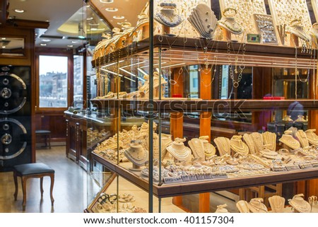 Florence, Italy - September 16, 2015: Golden jewellery in one of the jewellery shops on Ponte Vecchio bridge in Florence, Italy - stock photo