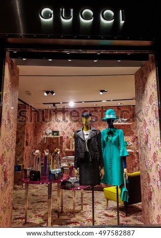 FLORENCE, ITALY-SEPTEMBER 21, 2016: Gucci luxury bags, clothes and shoes sit displayed for sale inside a Gucci store.