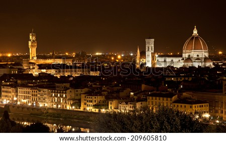 FLORENCE, ITALY - 11 SEPTEMBER, 2013: Night view on Florence, Italy on 11 September. Its Medieval stone arch bridge over the Arno River noted for still having shops built along it.