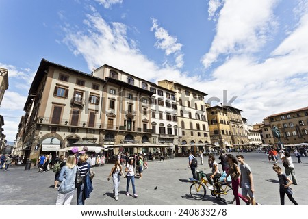 Florence, Italy  September 2: People of all ages enjoying a sunny morning in Piazza della Signoria. September 2, 2014 in Florence, Italy. - stock photo