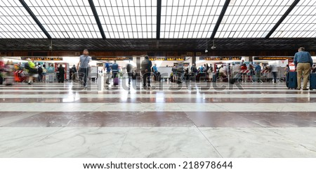 FLORENCE, ITALY - SEPTEMBER 17, 2014: People rushing inside train Station of SMN. The station was designed in 1932 by a group of architects known as the Gruppo Toscano (Tuscan Group). - stock photo