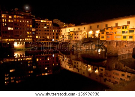 FLORENCE, ITALY - 11 SEPTEMBER, 2013: Ponte Vecchio in Florence, Italy on 11 September. It is a Medieval stone arch bridge over the Arno River noted for still having shops built along it.