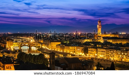 Florence, Italy - skyline view over Arno river with Ponte Vecchio and Palazzo Vecchio at twilight - stock photo