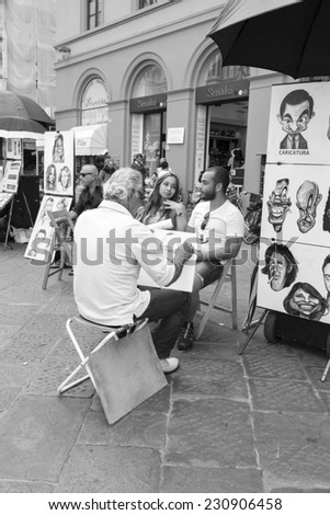 FLORENCE, ITALY - 15th of August 2014: Public painter on the square next the Duomo church on 15th of August 2014 in FLORENCE, ITALY (black and white)