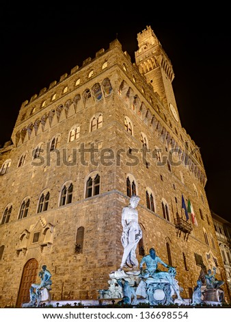 Florence, Italy: the antique statue of Neptune, the god of the sea in roman mythology, an famous monument of the italian Renaissance,  in front of the Palazzo Vecchio - stock photo