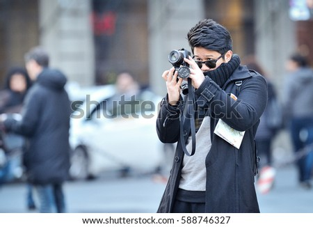 FLORENCE, ITALY - Tourist take photography near the cathedral Santa Maria del Fiore, in Florence, Italy, on december, 24