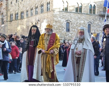 FLORENCE - JANUARY 6: Cavalcade of the Magi, consisting of a procession of characters that goes to Duomo, where bring up the offerings to the Christ Child on January 6, 2012 in Florence Italy. - stock photo
