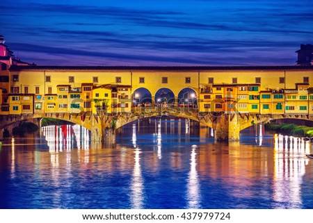 Florence. Late evening sunset at bridge Ponte Vecchio with houses in Firenze old town on Arno river, Tuskany region Italy. Europian Italian famous landmark in Florence old town with night illumination - stock photo