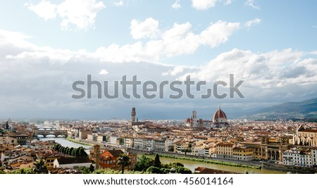 Florence looks gorgeous while white clouds fly over it in a sunny day