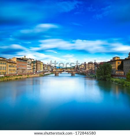 Florence or Firenze, Santa Trinita and Old Bridge landmark on Arno river, sunset landscape with reflection. Tuscany, Italy. Long exposure. - stock photo