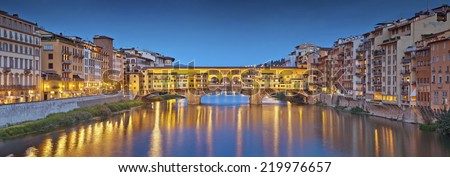 Florence. Panoramic image of historical center of Florence with Ponte Vecchio during twilight blue hour.
