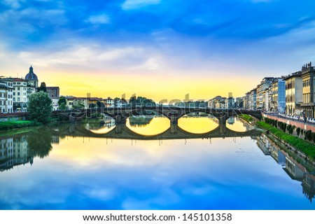 Florence, Ponte alla Carraia medieval Bridge landmark on Arno river, sunset landscape with reflection. It is the second oldest bridge, built in 1218, in the city. Tuscany, Italy. - stock photo