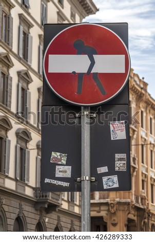 Florence, Tuscany, Italy, EU - Septembre 18, 2012: artistic intervention in a traffic signal