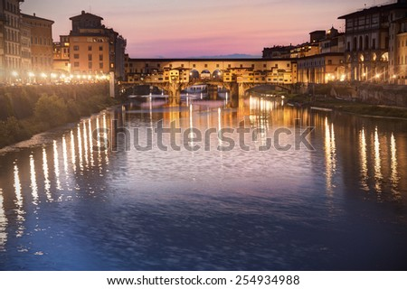 Florence, Tuscany, Italy: Ponte vecchio at dusk - stock photo