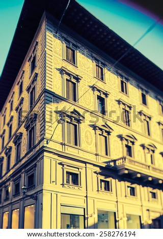 """Florentine building facade. Photo executed in a range of """"cross processing"""" - stock photo"""