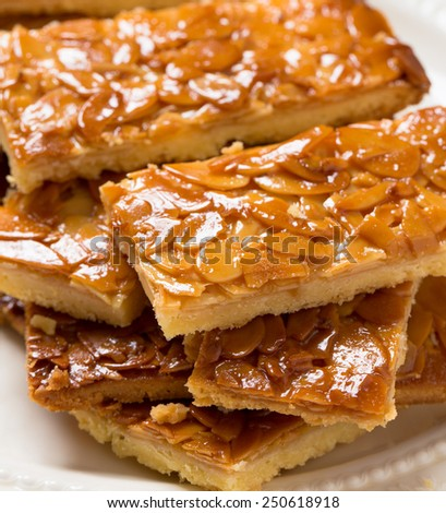 Florentines are thin shortbread cookies covered with candied almond  - stock photo