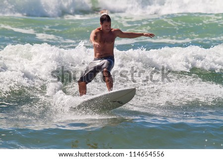 FLORIANOPOLIS, BRAZIL - FEB 3: A surfer enjoying one of the several beaches on Feb 3, 2012 in Florianopolis, Brazil.