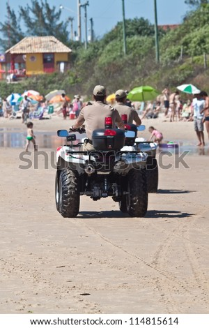 FLORIANOPOLIS, BRAZIL - FEB 3: Police officers patrol the beach to keep visitors safe on Feb 3, 2012 in Florianopolis, Brazil.