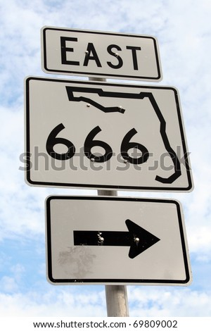 Florida East Highway 666 right Sign in Madeira Beach Florida. - stock photo