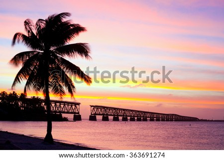 Florida Keys, Bahia Honda state park , landmark broken Flagler  bridge at sunset with beautiful colorful sky