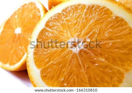 Florida navel oranges cut in half on white - stock photo