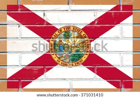 Florida state flag of America on brick wall - stock photo